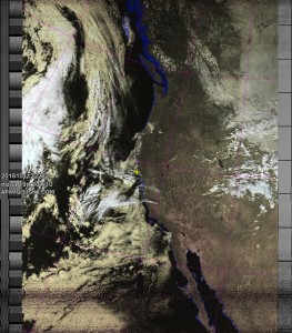 NOAA 19 northbound 78E at 11 Oct 2016 22:21:26 GMT on 137.10MHz, HVC-precip enhancement, Normal projection, Channel A: 2 (near infrared), Channel B: 4 (thermal infrared)